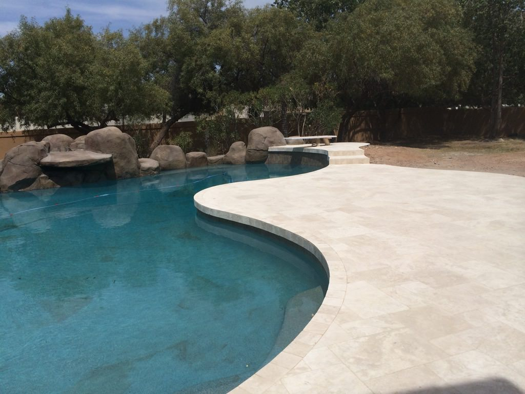 Beige large squared tile surrounding pool in phoenix