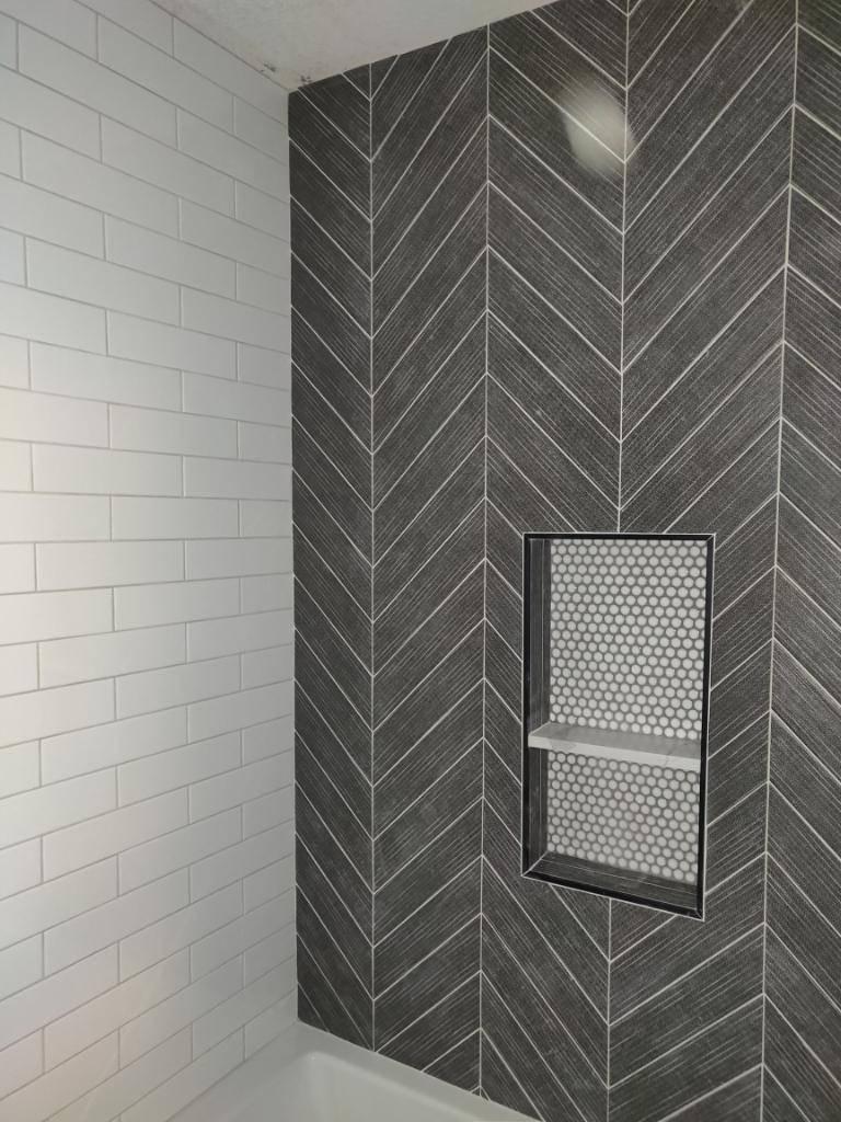 White subway tile and gray diagonal tile shower