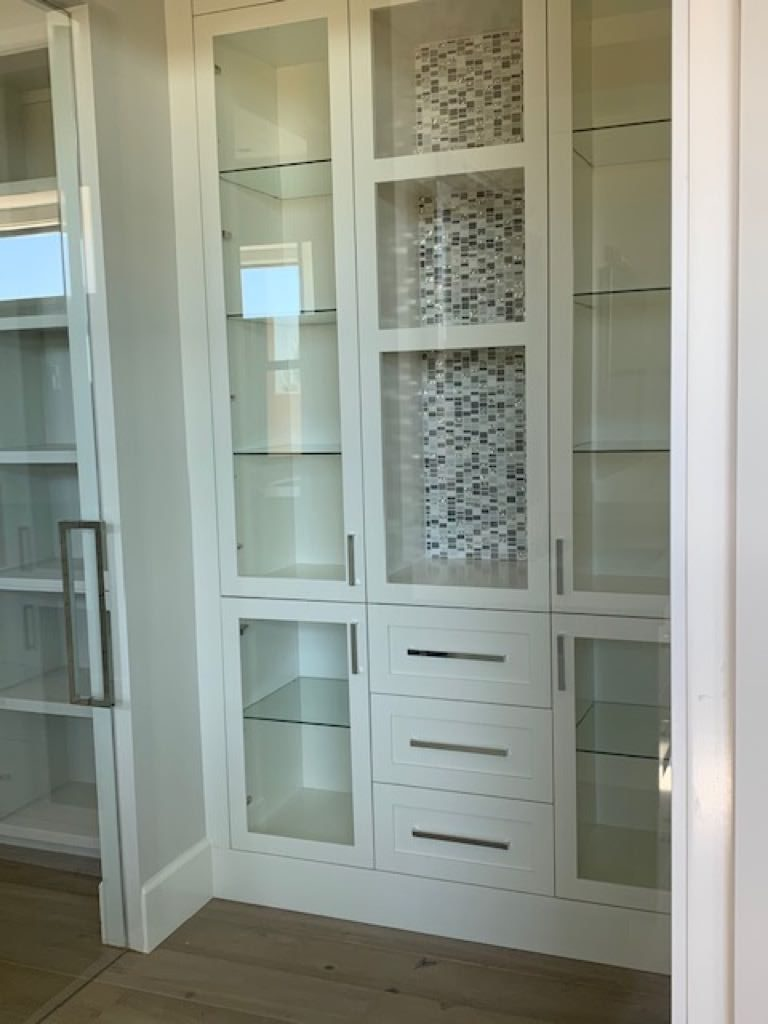 Glass tile accent wall in walk-in closet