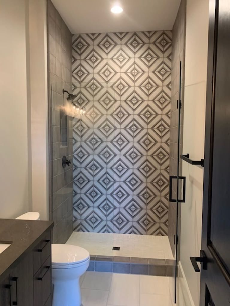 Grey and white diamond patterned shower