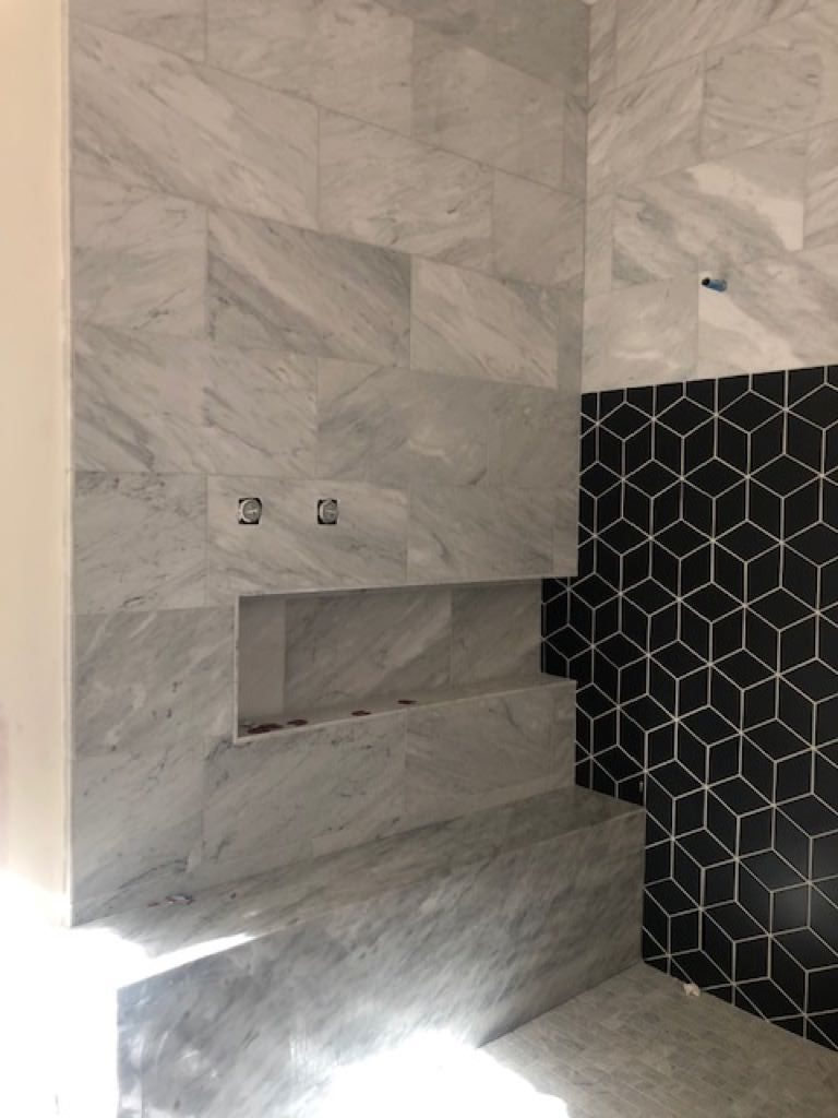 gray stone and black cement tile shower