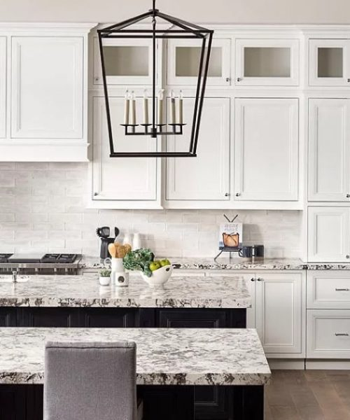 Kitchen tile and stone installation with marble countertops and ceramic backsplash